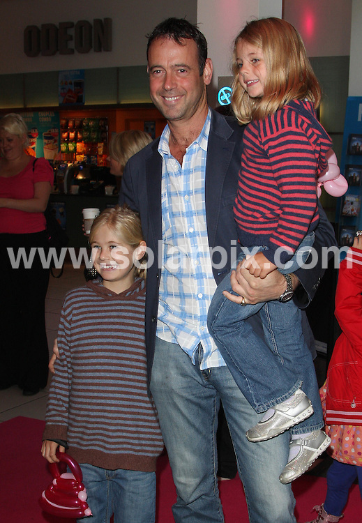 **ALL ROUND PICTURES FROM SOLARPIX.COM**.**WORLDWIDE SYNDICATION RIGHTS**.The DVD Premiere of Barbie And The Three Musketeers at the Odeon Cinema in Leicester Square, London...This pic:Lance Gerrard-Wright & children..JOB REF: 10026      LNJ     DATE:27.09.09.**MUST CREDIT SOLARPIX.COM OR DOUBLE FEE WILL BE CHARGED**.**MUST NOTIFY SOLARPIX OF ONLINE USAGE**.**CALL US ON: +34 952 811 768 or LOW RATE FROM UK 0844 617 7637**