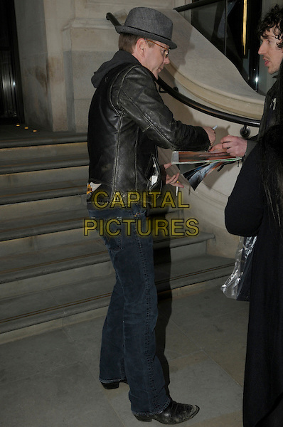 Kiefer Sutherland .leaving his hotel in London, England, UK, 8th March 2012..full length jeans grey gray hat black leather jacket sunglasses cigarettes smoking signing autographs side .CAP/IA.©Ian Allis/Capital Pictures.