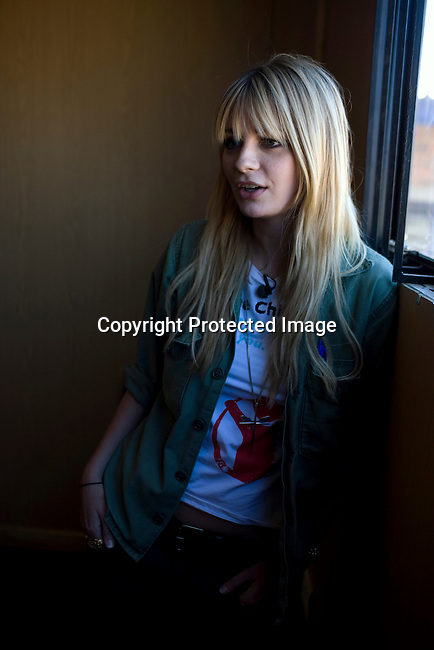 SOWETO, SOUTH AFRICA - SEPTEMBER 1: Mischa Barton, the actress and model, stands inside trailer at Winnie Ngwevekazi Primary School on September 1, 2008 in Soweto, outside Johannesburg, South Africa. Mischa Barton spent 2 days visiting Save The Children supported projects in South Africa, meeting school children and young children. Save The Children are helping about 51,000 children made by HIV/AIDS and poverty to access food, healthcare, social security and education. (Photo by Per-Anders Pettersson/Getty Images For Save The Children).