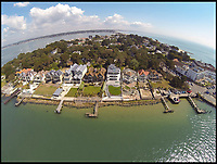 BNPS.co.uk (01202) 558833<br /> Pic: Lloyds/BNPS.<br /> <br /> &pound;100 million pound row...<br /> <br /> Lucky 13 - This tiny 850 ft stretch of seafront on the exclusive Sandbanks peninsular in Dorset is now thought to be the most expensive seaside real estate in the world.<br /> <br /> The 850ft long stretch of Panorama Road that boasts uninterupted views to the south west contains only 13 harbourside mansions that total a staggering &pound;92.7m in value.<br /> <br /> There is also almost total privacy from the road out front while back gardens run down to the water's edge.<br /> <br /> But the plots are relatively narrow, ranging between 40ft and 60ft wide, making it the most expensive piece of coastline in the world in term of price per square foot.