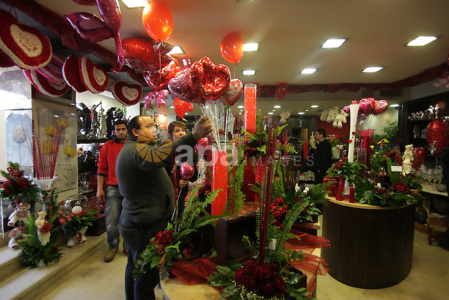 A Palestinian vendor prepares gifts for Valentine's Day at his shop in the biblical town of Bethlehem, on February 13, 2011. Valentine's Day marks a Christian holiday on Feb, 14.. Photo by Najeh Hashlamoun