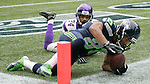 Seattle Seahawks wide receiver Golden Tate pick himself up after hauling in a six-yard touchdown pass from quarterback Russell Wilson in front of Minnesota Vikings cornerback A.J. Jefferson at CenturyLink Field in Seattle, Washington on  November 4, 2012.    The Seahawks beat the Vikings 30-20.     ©2012. Jim Bryant Photo. All Rights Reserved.
