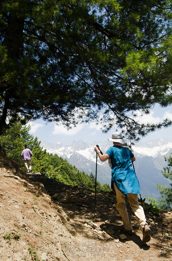 Western tourist climbing up steep trail in the stunning alpine wonderland above Naranag, Kashmir, India.