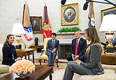 United States President Donald Trump (2nd-R) and first lady Melania Trump (R) meet with Canadian Prime Minister Justin Trudeau (2nd-L) and his wife Sophie Grégoirein the Oval Office at the White House in Washington, D.C. on October 11, 2017. <br /> Credit: Kevin Dietsch / Pool via CNP