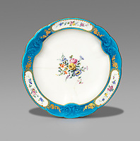 BNPS.co.uk (01202 558833)<br /> Pic: Woolley&Wallis/BNPS<br /> <br /> £13 cracked plate sold for £31,000.<br /> <br /> One woman's lifetime collection of French porcelain that filled 'every nook and cranny' of her modest home sold for £373,000 yesterday, over £125,000 over estimate.<br /> <br /> The late Judith Howard's passion for 18th century gallic ceramics saw the walls, shelves and display cabinets adorned with hundreds of plates, dishes and bowls.<br /> <br /> She was well known for having an eye for a bargain, so much so that a 250-year-old plate she bought for £13 at an antiques shop sold for £31,000.<br /> <br /> The item was once part of the 1,735 dinner service set made for French King Louis XV and housed in the Palace of Versailles.
