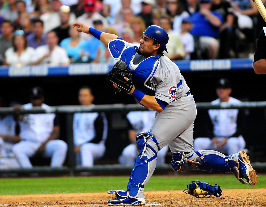 August 8, 2009: Cubs catcher Geovany Soto attempts to throw out a baserunner during a regular season game between the Chicago Cubs and the Colorado Rockies at Coors Field in Denver, Colorado. The Cubs beat the Rockies 6-5. *****For editorial use only*****