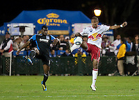 Juan Agudelo (right) kicks the ball against Brandon McDonald (left). The New York Red Bulls defeated the San Jose Earthquakes 1-0 at Buck Shaw Stadium in Santa Clara, California on October 30th, 2010.