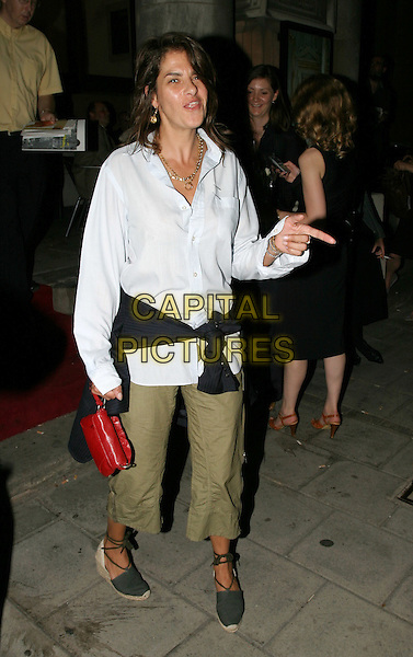 TRACY EMIN.Royal Academy of Arts - Party.May 19th, 2004.Tracey, full length, full-length, blue shirt, green three quarter length, trousers, sweater tied around waist, red bag, purse.www.capitalpictures.com.sales@capitalpictures.com.© Capital Pictures.