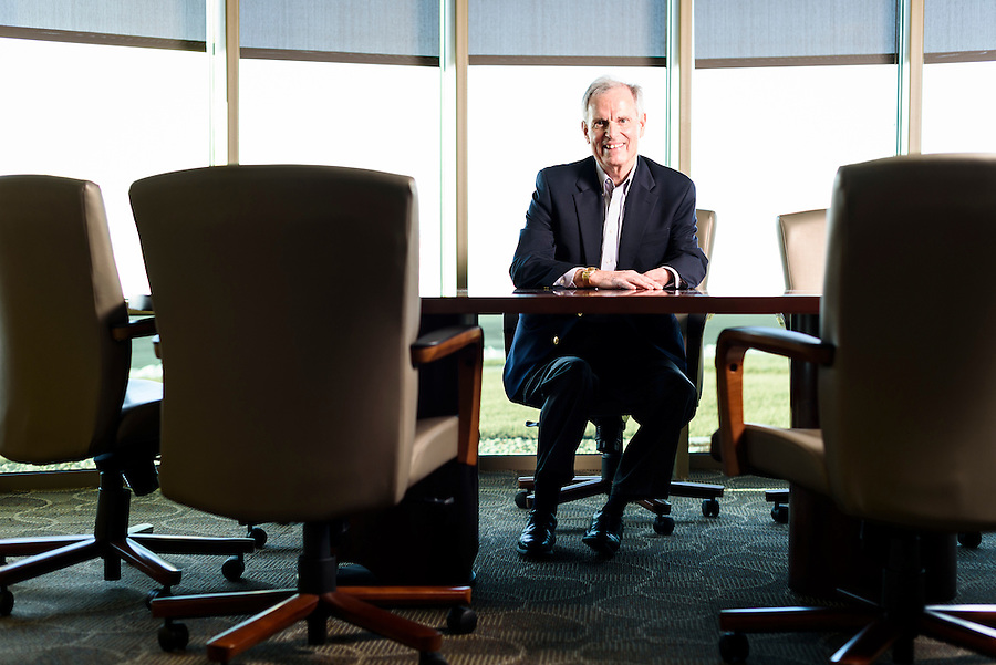"""Bill Schultz, executive recruiter for Sales Consultants of Madison, is pictured in an office conference room in Madison, Wis., on Jan. 23, 2016. Schultz, born with arm and leg deformities, is also author of the autobiographical book, """"Short-Handed: A Young Boy's Triumph Over Adversity."""" (Photo by Jeff Miller, www.jeffmillerphotography.com)"""