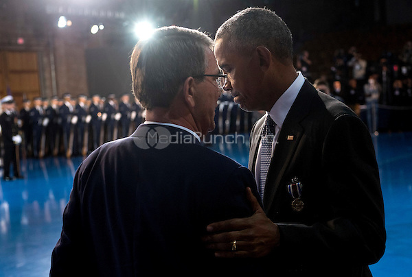 United States President Barack Obama shakes hands with Secretary of Defense Ashton Carter during President Obama's Armed Forces Full Honor Review Farewell Ceremony at Joint Base Myers-Henderson Hall, in Virginia on January 4, 2017. The five braces of the military honored the president and vice-president for their service as they conclude their final term in office. <br /> Credit: Kevin Dietsch / Pool via CNP /MediaPunch