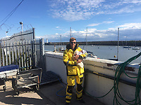 MUST BYLINE RNLI/BARRY DOCK<br /> Pictured: Chris White at Barry Dock Lifeboat Station<br /> Re: A dad delivered his own baby son at the side of the road.<br /> Lifeboat volunteer Chris White was forced to pull over while ferrying his wife Nicole to the hospital with labour pains.<br /> Their son was born straight into the delighted parents' arms as traffic passed the family parked in a busy residential area.<br /> As a crew member for Barry Dock Lifeboat Station, Chris had completed casualty care training, but had never dealt with a labour before.<br /> Chris used one of his shoelaces as a clamp for the umbilical cord and his shirt to cover the newborn.<br /> He and Nicole were excitedly anticipating the arrival of their second child when Nicole's contractions started at about 10am on Friday, August 9.<br /> The couple phoned the hospital, but medical staff decided Nicole was far from ready to give birth.<br /> Taking the advice in her stride, Nicole carried on with her day, until the contractions became more intense and she found them difficult to ignore.