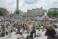 More than 2,000 square metres of turf laid on Trafalgar Square as part of Visit London's campaign to promote green spaces and villages in the city.