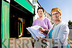 Post office customer Kathleen O'Malley with Killorglin postmistress Nora O'Sullivan Looney with the petition for the government to help rural post offices stay open.