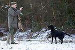 Pix: Shaun Flannery/shaunflanneryphotography.com...COPYRIGHT PICTURE>>SHAUN FLANNERY>01302-570814>>07778315553>>..19th December 2009................Brodsworth Shoot..A black Labrador retrieves a bird to gun.