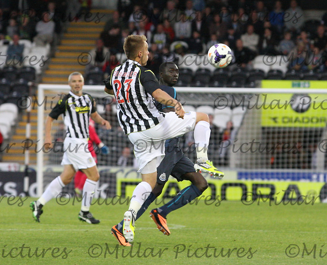 Danny Grainger gets to the ball before Papiss Cisse in the St Mirren v Newcastle United friendly match played at St Mirren Park, Paisley on 30.7.13.