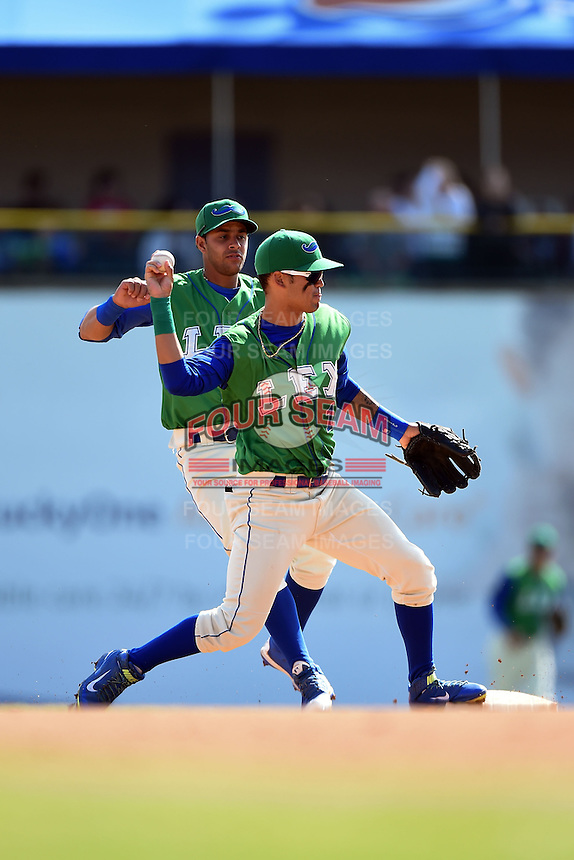 Lexington Legends shortstop Humberto Arteaga (1) attempts to turn a double play as second baseman Ramon Torres (2) backs up the play during a game against the Hagerstown Suns on May 19, 2014 at Whitaker Bank Ballpark in Lexington, Kentucky.  Lexington defeated Hagerstown 10-8.  (Mike Janes/Four Seam Images)