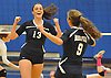 Massapequa No. 13 Mackenzie Byrne, left, and No. 9 Gabriella Azzariti react after their team won the first set by a score of 25-16 in a Nassau County varsity girls' volleyball match against host Plainview JFK High School on Monday, October 19, 2015. Massapequa went on to win 25-16, 25-8, 25-13.<br /> <br /> James Escher