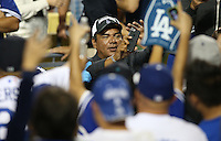 September 24, 2014 Los Angeles, CA: Actor George Lopez is all smiles after an MLB game between the San Francisco Giants and the Los Angeles Dodgers played at Dodger Stadium The Dodgers defeated the Giants 9-1 to win the National League West Title.
