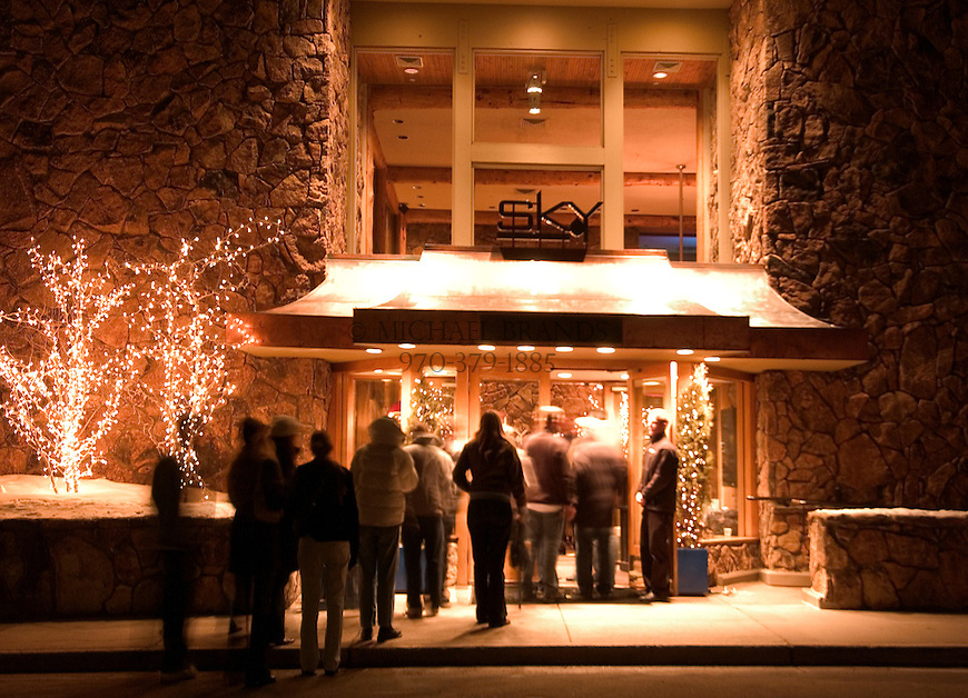 People wait outside the Sky Hotel to get into the 39 Degrees bar Friday night in Aspen, CO. © Michael Brands.
