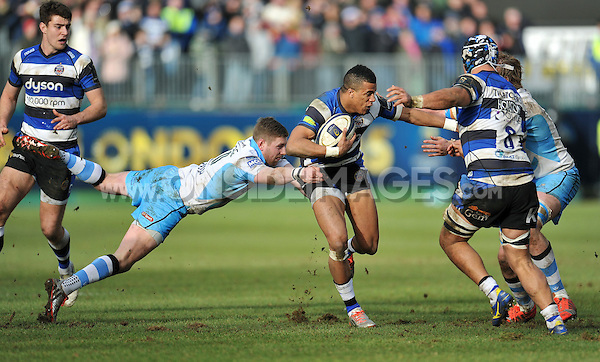 Anthony Watson of Bath Rugby takes on the Glasgow defence. European Rugby Champions Cup match, between Bath Rugby and Glasgow Warriors on January 25, 2015 at the Recreation Ground in Bath, England. Photo by: Patrick Khachfe / Onside Images