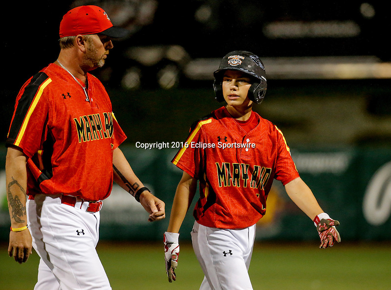 ABERDEEN, MD - AUGUST 01: Jonathan Klein #6 of Bel Air (MD) talks with Manager Darrell Barrett #27 of Bel Air (MD) after being tagged out trying to steal 3rd base in the 2nd inning during a game between Pacific Southwest and Maryland during the Cal Ripken World Series at The Ripken Experience Powered by Under Armour on August 1, 2016 in Aberdeen, Maryland. (Photo by Ripken Baseball/Eclipse Sportswire/Getty Images)