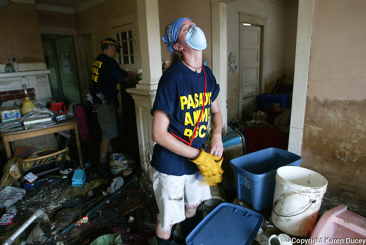 The heat is overbearing for Pasados Safe Haven animal rescuer, Janine Clyman, from Seattle after she rescues a cat (one of four)  from a home 2520 Acacia St. in New Orleans.  © Karen Ducey