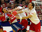 Dalibor Cutura (L) of Serbia and Henrik Toft Hansen (R) of Denmark in action during men`s EHF EURO 2012 handball championship final game between Serbia and Denmark in Belgrade, Serbia, Sunday, January 29, 2011.  (photo: Pedja Milosavljevic / thepedja@gmail.com / +381641260959)