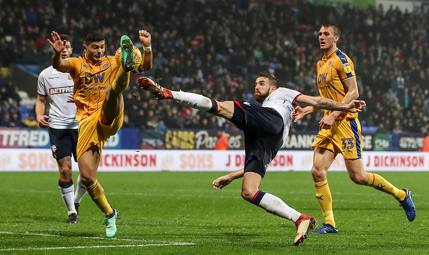 Bolton Wanderers' Mark Beevers competing with Wigan Athletic's Sam Morsy who appeared to handle the ball in the Bolton penalty area.<br /> <br /> Photographer Andrew Kearns/CameraSport<br /> <br /> The EFL Sky Bet Championship - Bolton Wanderers v Wigan Athletic - Saturday 1st December 2018 - University of Bolton Stadium - Bolton<br /> <br /> World Copyright © 2018 CameraSport. All rights reserved. 43 Linden Ave. Countesthorpe. Leicester. England. LE8 5PG - Tel: +44 (0) 116 277 4147 - admin@camerasport.com - www.camerasport.com