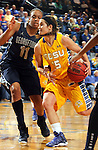 BROOKINGS, SD - NOVEMBER 15:  Steph Paluch #15 from South Dakota State University drives against Andrea White #11 from Georgetown in the second half of their game Friday night at Frost Arena. (Photo by Dave Eggen/Inertia)