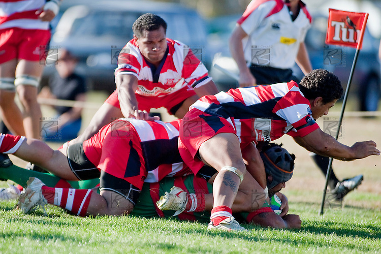 Maka Tatafu crashes over near the corner flag to score Waiuku's only try  late in the game. Counties Manukau Premier Club Rugby game bewtween Waiuk & Karaka played at Waiuku on Saturday April 11th, 2010..Karaka won the game 24 - 22 after leading 21 - 9 at halftime.