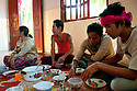 SREY BREY VILLAGE, CAMBODIA-- Young Imam San Cham men dine in the bride and groom's new home during three days of wedding rituals in Kampong Chhnang province.  PHOTO BY JODI HILTON