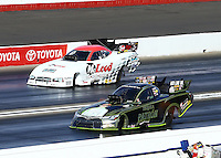 Feb 14, 2016; Pomona, CA, USA; NHRA funny car driver Alexis DeJoria (near) defeats Jim Campbell during the Winternationals at Auto Club Raceway at Pomona. Mandatory Credit: Mark J. Rebilas-USA TODAY Sports
