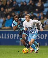 George Thomas of Coventry City & Marcus Bean of Wycombe Wanderers during the The Checkatrade Trophy - EFL Trophy Semi Final match between Coventry City and Wycombe Wanderers at the Ricoh Arena, Coventry, England on 7 February 2017. Photo by Andy Rowland.