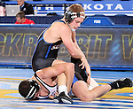 BROOKINGS, SD - JANUARY 11:  Austin Oyen from South Dakota State University controls Mito Mendivil from Dakota Wesleyan in their 149 pound match Sunday afternoon at Frost Arena in Brookings. (Photo by Dave Eggen/Inertia)