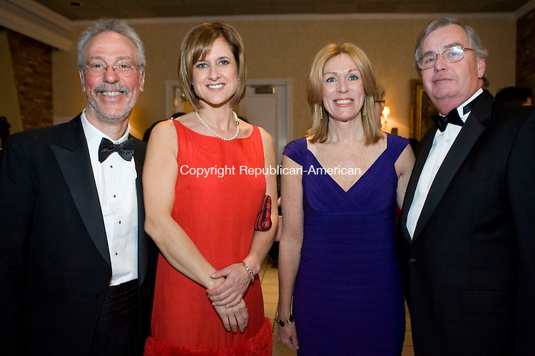 PLANTSVILLE, CT - 07 FEBRUARY 2009 -020709JT21-<br /> From left, Peter Jacoby, MD, with Kristen Bukovitch and Laurie and Bill St. John at Saint Mary's Hospital's 18th annual gala, &quot;100 Years of Caring,&quot; sponsored by the Saint Mary's Hospital Foundation, on Saturday, Feb. 7 at the Aqua Turf in Plantsville. Proceeds benefit patient care services.<br /> Josalee Thrift / Republican-American