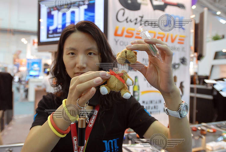 A sales rep shows various USB storage devices manufactured by her Mainland China company at the new Taipei World Trade Center Nangang Exhibition Hall, which hosted the COMPUTEX trade show. The show is the biggest of its kind and attracts many exhibitors from the multitude of Taiwanese companies as well as traders and exhibitors from around the world.
