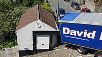 Pictured: The David Hathaway articulated lorry which became stuck on Constitution Hill, Wales, UK. Monday 15 July 2019<br /> Re: An articulated lorry that got stuck in Swansea's steepest road, had to be towed away.<br /> The David Hathaway vehicle was attempting to turn from Brooklands Terrace to Constitution Hill just after 11am but successive attempts by the driver proved difficult as the wheels kept losing traction.<br /> Police, a fire service vehicle and a recovery truck attended which helped free the lorry.