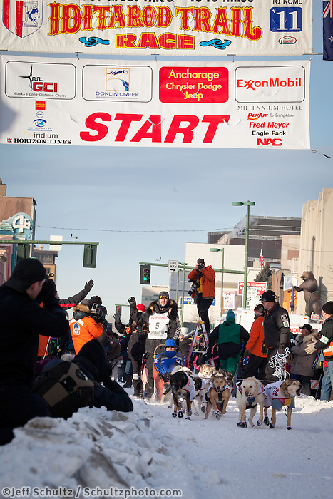 Musher Allen Moore and Iditarider Phil Woare.leave the 2011 Iditarod ceremonial start line in downtown Anchorage, Alaska