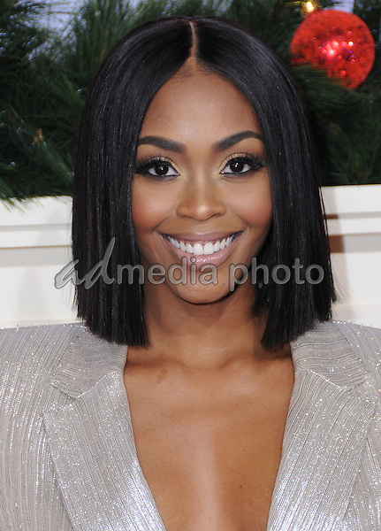 "03 November 2016 - Westwood, California. Nafessa Williams. Premiere Of Universal's ""Almost Christmas"" held at Regency Village Theatre. Photo Credit: Birdie Thompson/AdMedia"