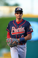 Peoria Chiefs shortstop Oscar Mercado (4) jogs to the dugout during a game against the Lansing Lugnuts on June 6, 2015 at Cooley Law School Stadium in Lansing, Michigan.  Lansing defeated Peoria 6-2.  (Mike Janes/Four Seam Images)