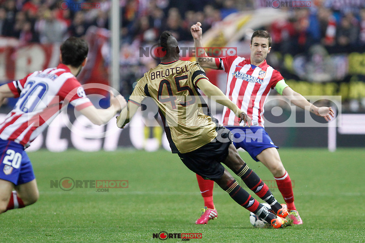 Atletico de Madrid´s Gabi (R) and Milan´s Balotelli during 16th Champions League soccer match at Vicente Calderon stadium in Madrid, Spain. January 06, 2014. (ALTERPHOTOS/Victor Blanco)