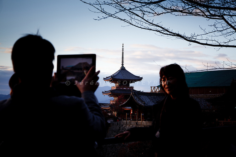Kyoto, November 24 2011 - At Kiyomizu-dera in Kyoto. A Japanese man taking pictures with his ipad.