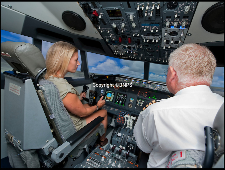 BNPS.co.uk (01202 558833)<br /> Pic: Collect/BNPS<br /> <br /> So succesful is the course that students finish off actually flying the simulator.<br /> <br /> Emily Kaye(38) piloting the 737-800 simulator with Capt Andy Wilkins on the life changing course.<br /> <br /> The sky's the limit...<br /> <br /> A pilot has launched a state-of-the-art virtual aeroplane to help people tackle their flying phobias head on.<br /> <br /> Captain Andy Wilkins, 56, has built a replica Boeing 737-800 complete with an aircraft cabin, cockpit, and flight simulator.<br /> <br /> It has been made to look exactly how a real aeroplane would with tiny windows, overhead lockers, seats with limited leg room and a narrow aisle.<br /> <br /> The model also features example messages and announcements from the crew and sounds that can often terrify people such as the hydraulic system.<br /> <br /> Andy shows members of the public who suffer with flying fears - otherwise known as Aviophobia - into the cabin and uses counselling techniques to calm their nerves.<br /> <br /> They then enter the cockpit of the aircraft where he shows them exactly how it works and discusses the process in detail from taking off to landing.<br /> <br /> At the end of the three-hour long course, the client will then have the opportunity to use the high-tech simulator to fly the plane themselves.<br /> <br /> Since launching the Virtual Jet Centre in Newton Abbot, Devon, four months ago, Andy has already helped eight people overcome their fears.