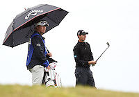 25 JAN 13 Belgian Bomber Nicolas Colsaerts in the steady rain during Friday's Second Round action  at The Farmers Insurance Open at Torrey Pines Golf Course in La Jolla, California. (photo:  kenneth e.dennis / kendennisphoto.com)