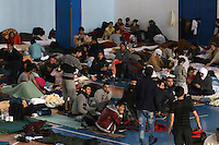 Pictured: Hundreds of migrants in Ierapetra basketball arena. Friday 28 November 2014<br /> Re: 700 migrants aboard a ship that lost power in the Mediterranean Sea with and was towed into a Greek harbor are being housed in a basketball arena while their refugee status was assessed.<br /> It took the Greek navy four days to tow the ship Baris from international waters into Ierapetra harbor, on the Greek island of Crete. The vessel lost power in storm-force winds.<br /> Many are Syrians fleeing the civil war. A senior health official on the island, Panayiotis Efstathiou, said many would be released.