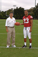 7 August 2006: Stanford Cardinal head coach Walt Harris and Brandon Harrison during Stanford Football's Team Photo Day at Stanford Football's Practice Field in Stanford, CA.