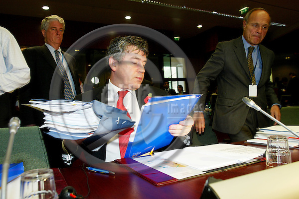 BRUSSELS - BELGIUM - 08 NOVEMBER 2005 -- ECOFIN Council meeting -- Gordon BROWN, Chancellor of the Exchequer of UK and the President of the Council, reading his documents. to his right Gregoire BROUHNS from the ECOFIN Section in the Council Secretariat.  PHOTO: ERIK LUNTANG / EUP-IMAGES..