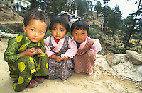 Three Tibetan girls in chubas.
