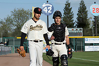 Visalia Rawhide starting pitcher Jeff Bain (20) and catcher Renae Martinez (9) walk towards the dugout before a California League game against the Rancho Cucamonga Quakes on April 9, 2019 in Visalia, California. Visalia defeated Rancho Cucamonga 8-5. (Zachary Lucy/Four Seam Images)