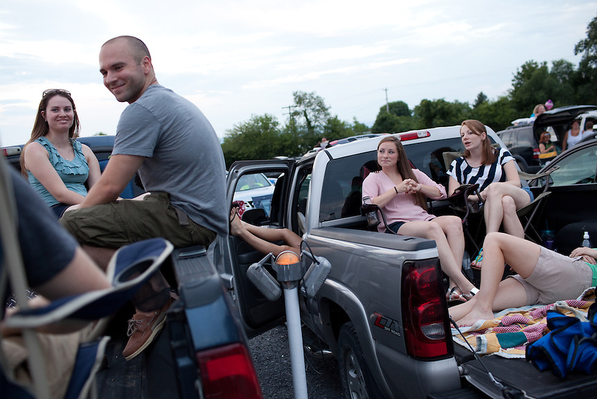 Friends hang out before the movie begins at Family Drive-In Theatre in Stephens City, Virginia on July 20, 2013. From left to right: Brittany Palmer of Mt. Jackson, VA, Billy Paxtion of Broadway, VA, Paige Frazier and  her sister Molly Frazier of New Market, VA. CREDIT: Lance Rosenfield/Prime